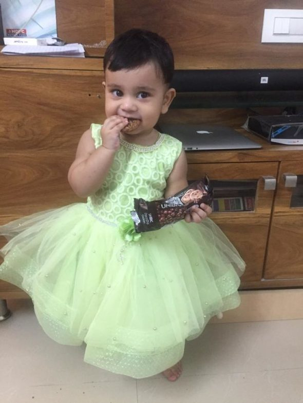 Sonia's daughter in a green dress.