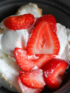 Angel food cake topped with strawberries.