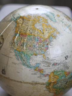 North American on a globe.