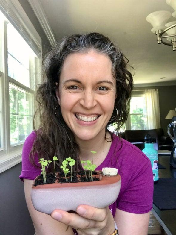 Kristen holding an Orta seed-starter pot.