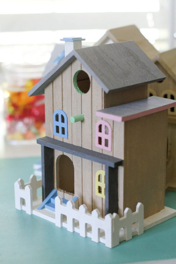 A painted two-level birdhouse.