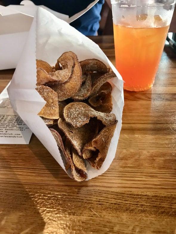 handmade sweet potato chips on a restaurant table.