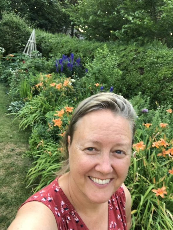 Shelagh in a flower garden.