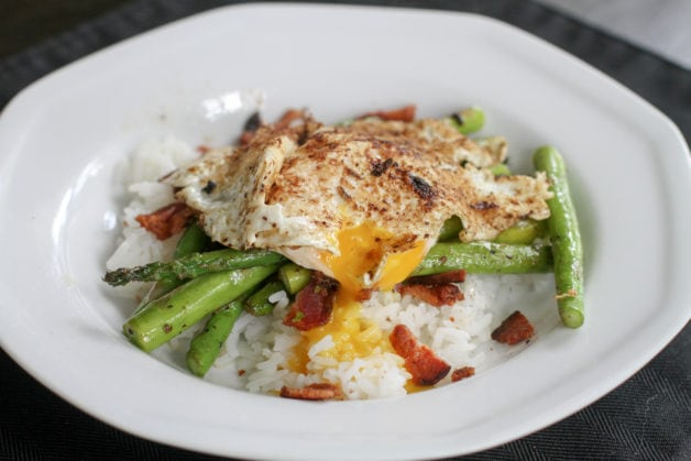 Rice bowl with veggies and a fried egg.