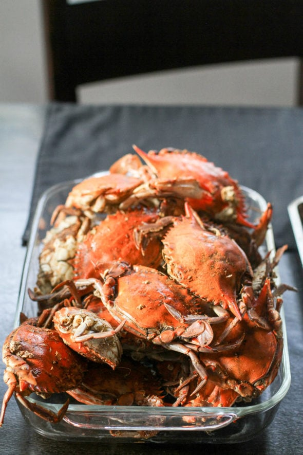 A glass dish of steamed crabs.