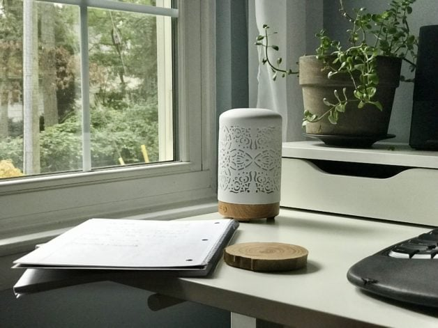 A white desk by a window.