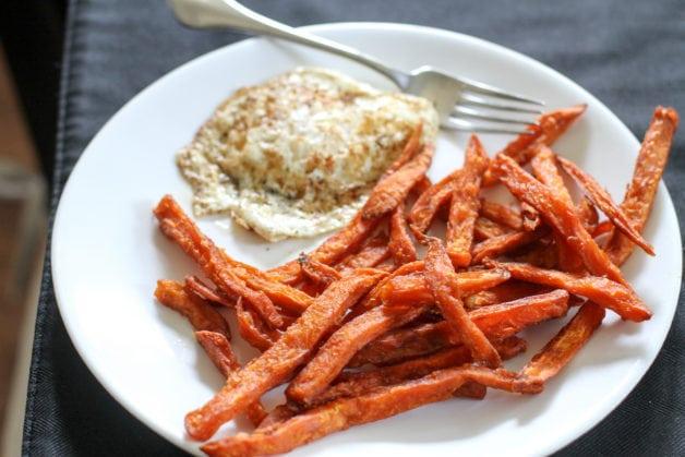 A fried egg and sweet potato fries.