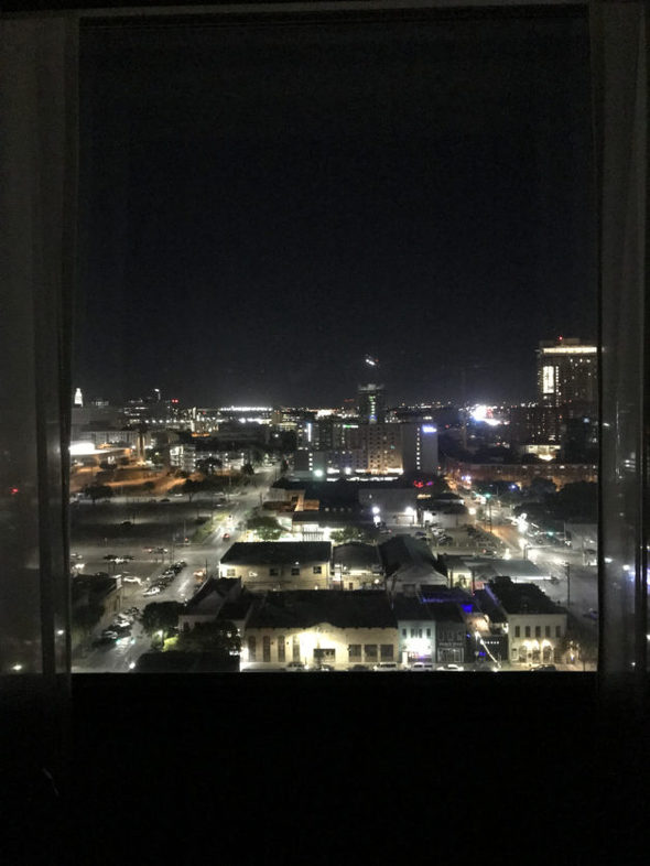 A view of the night sky from a city hotel room.