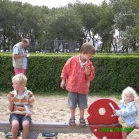 Children on a beachside bench.