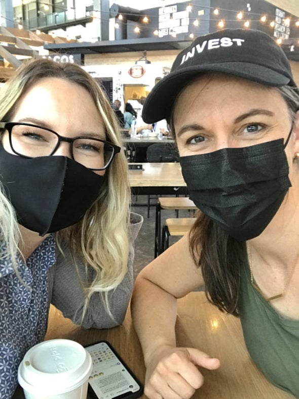 Kristen and Whitney with masks on.