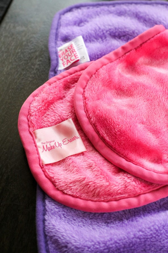 Makeup eraser cloths in pink and purple.