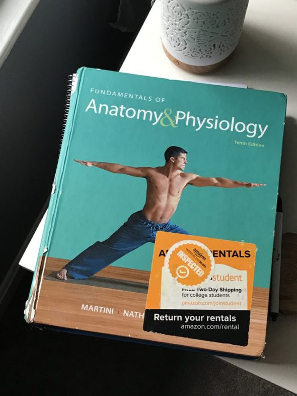 Anatomy and Physiology textbook with a green cover.