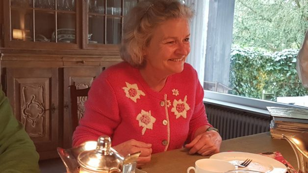 Miryam in a pink sweater, smiling.
