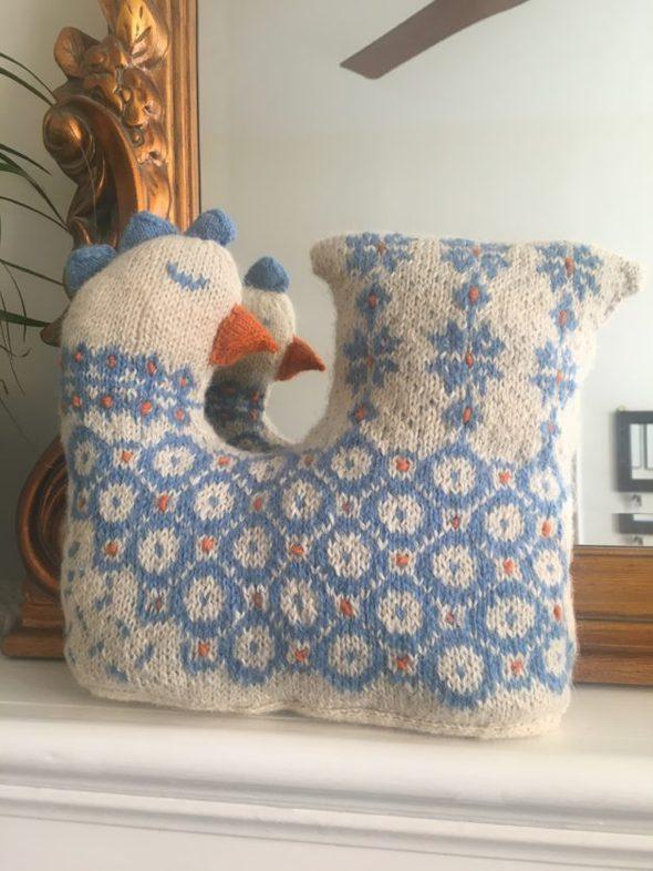 A knitting chicken doorstrop