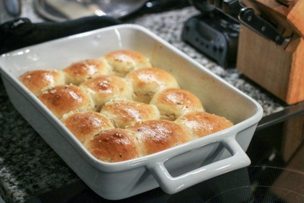 garlic rolls in a white dish.